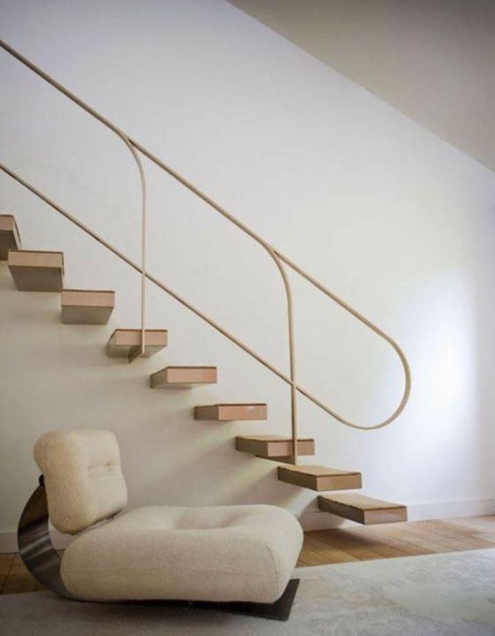 Oscar Niemeyer lounge chair, 1972. Interior design by Buttazoni & Accosies